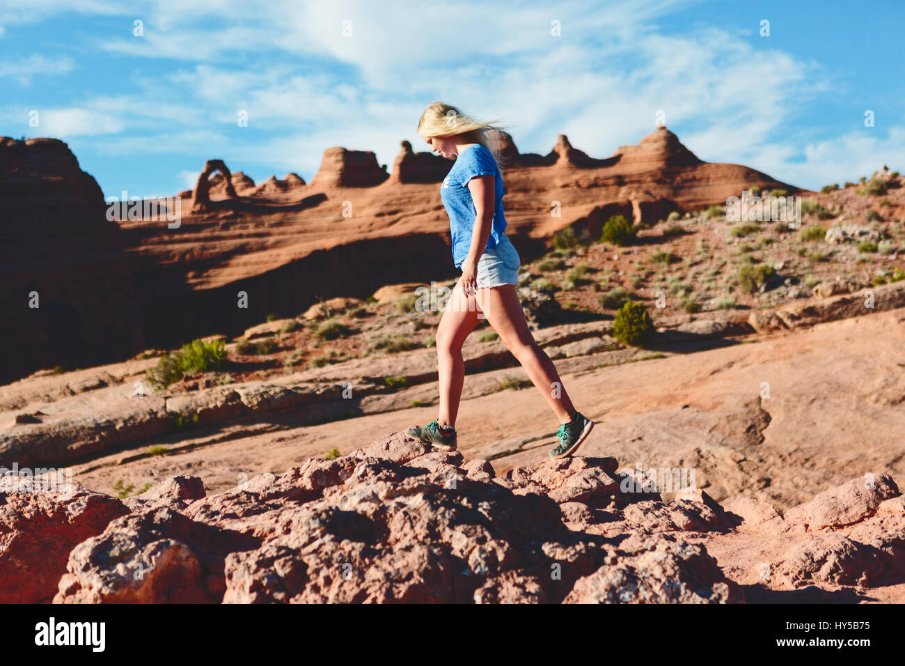 USA, Utah, Moab, Arches National Park, Woman walking on rocks - Stock Image