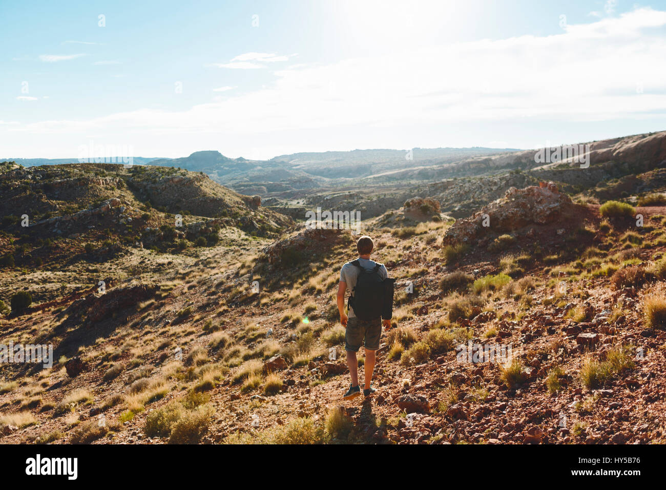 USA, Utah, Moab, Arches National Park, Man hiking in mountains - Stock Image