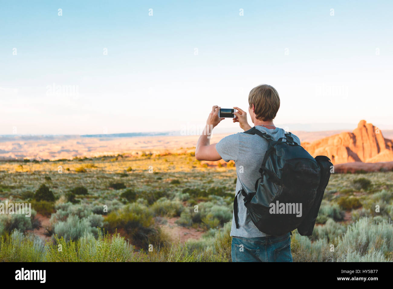 USA, Utah, Moab, Arches National Park, Man photographing landscape - Stock Image
