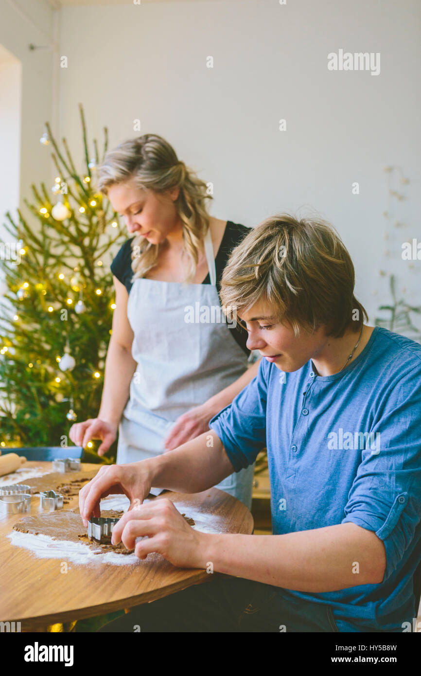Finland, Couple preparing christmas cookies - Stock Image