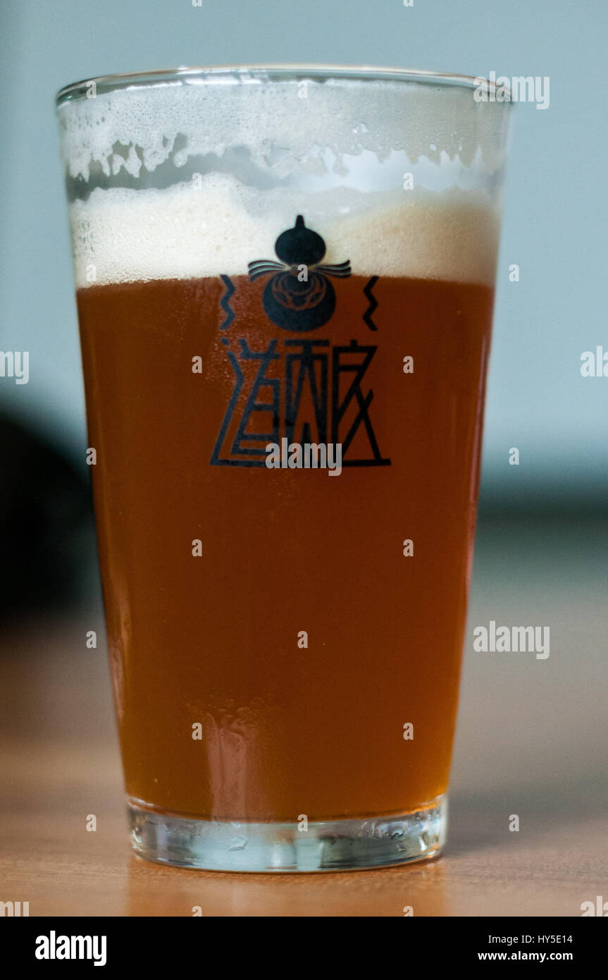 A cool glass of Chengdu's Harvest Brewery's IPA. - Stock Image