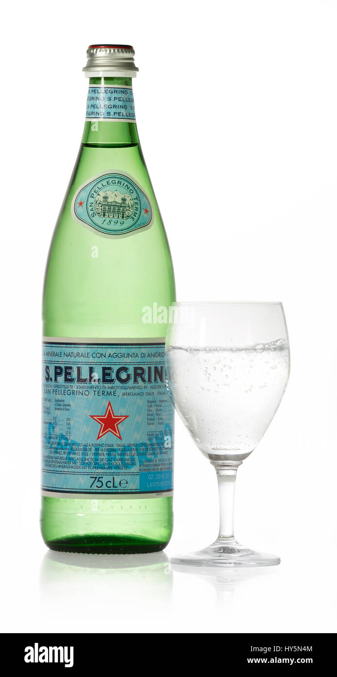 San Pellegrino mineral water, bottle and glass, clipping path available - Stock Image