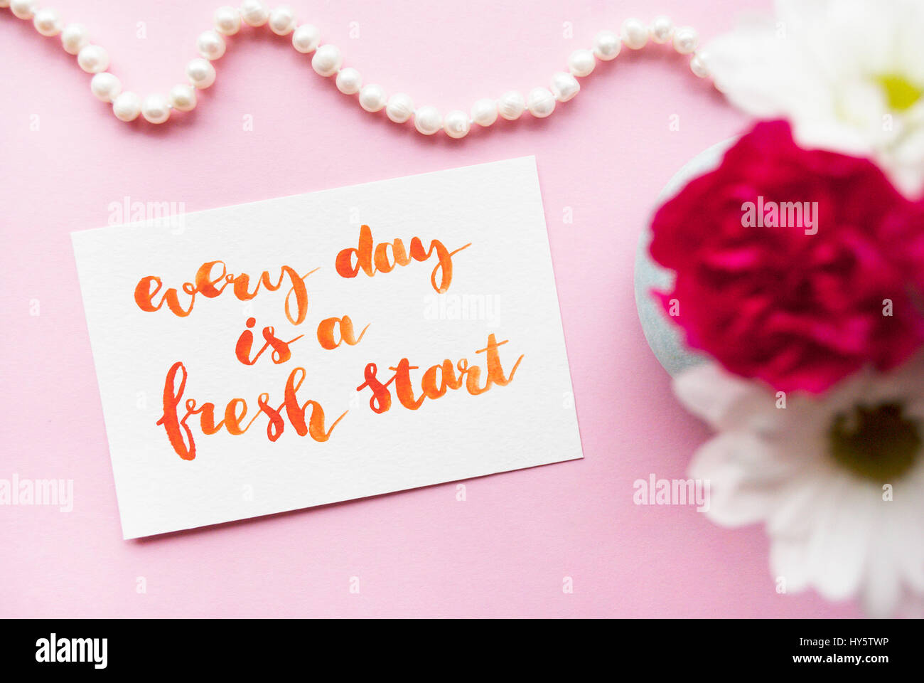 Inspirational quote Every day is a fresh start written in calligraphy style with watercolor. Composition on a pink - Stock Image