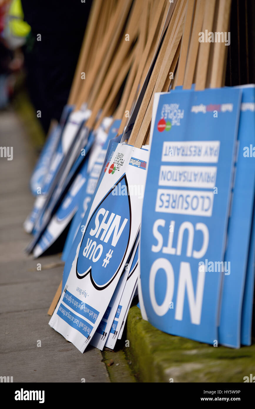 'Our NHS' was the name given to a protest march in London demonstrating against the cuts to and privatisation - Stock Image