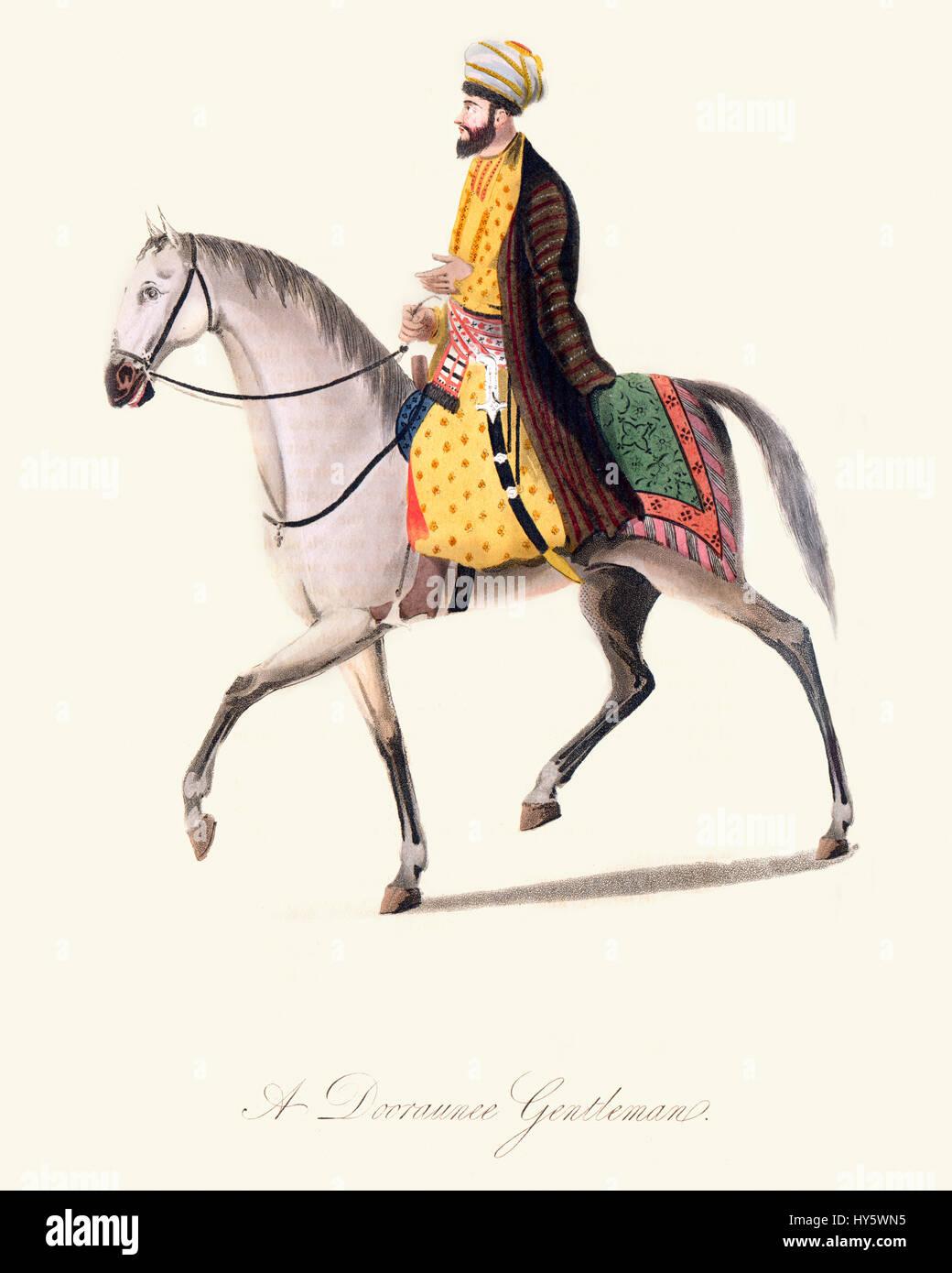Vintage colour engraving from 1819 showing an Afghan Dooraunee Gentleman on horseback - Stock Image