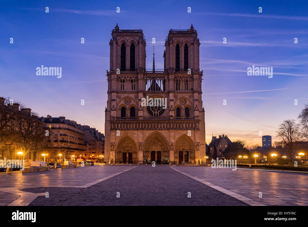 Notre Dame de Paris cathedral at sunrise. Ile de La Cite, Parvis Notre Dame (Place Jean-Paul II), 4th Arrondissement, - Stock Image