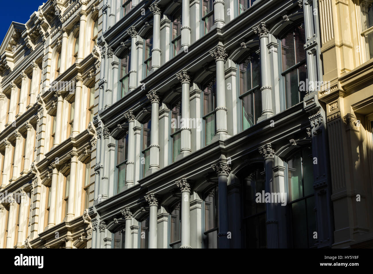 Painted 19th century facades in Manhattan's Soho neighborhood with cast iron columns and ornamentation. New - Stock Image