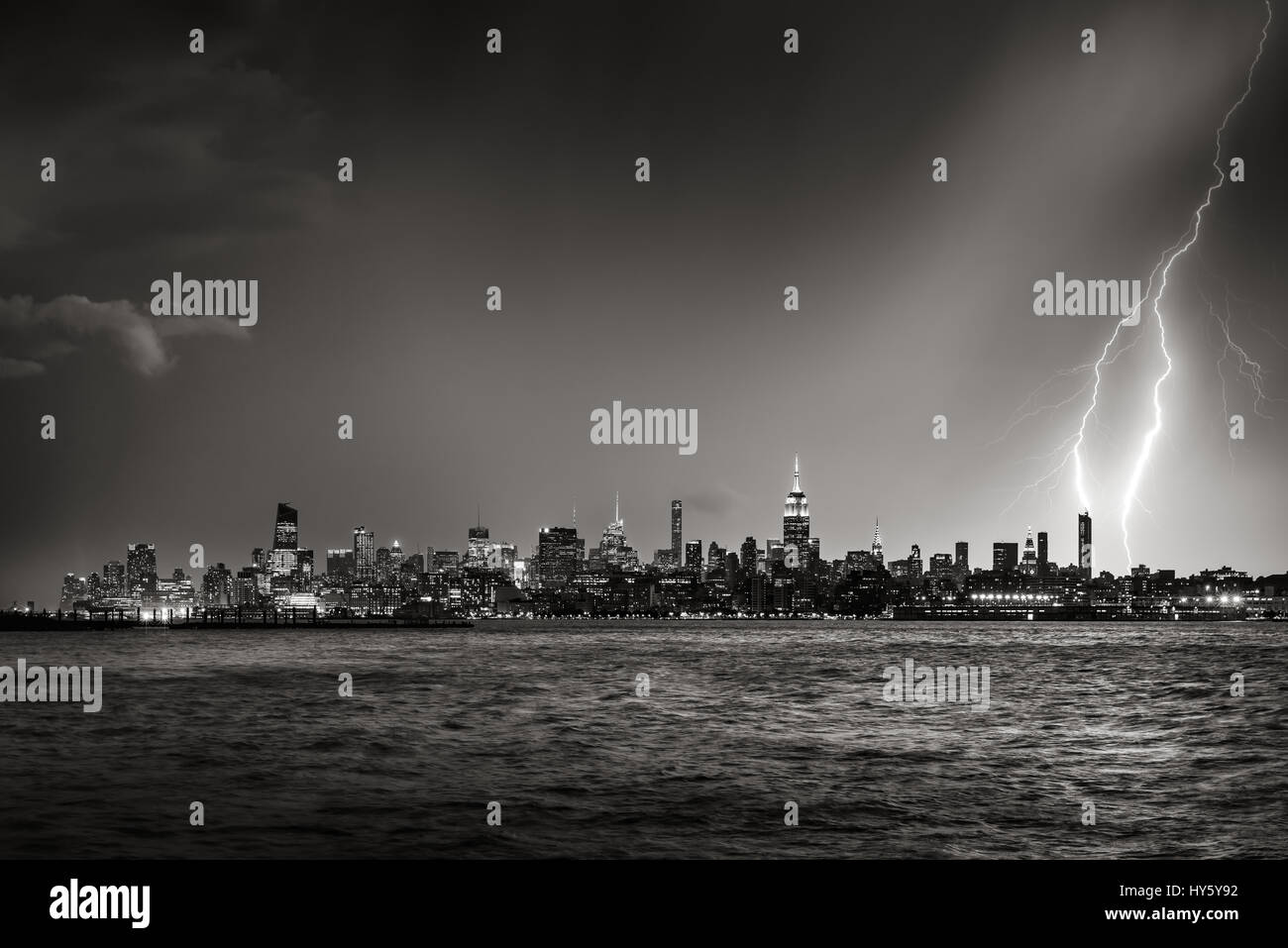 Lightning striking  New York City skyscraper at twilight (Black & White) - Stock Image