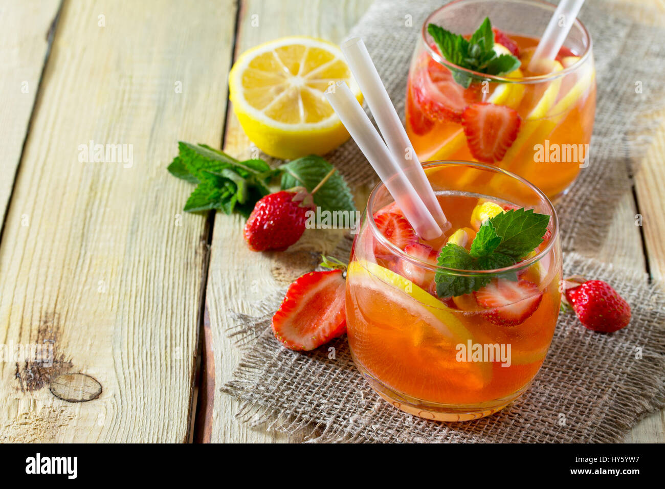 Fruit water. Refreshing summer drink with strawberries, lemon and mint. The concept of healthy and dietary nutrition. - Stock Image