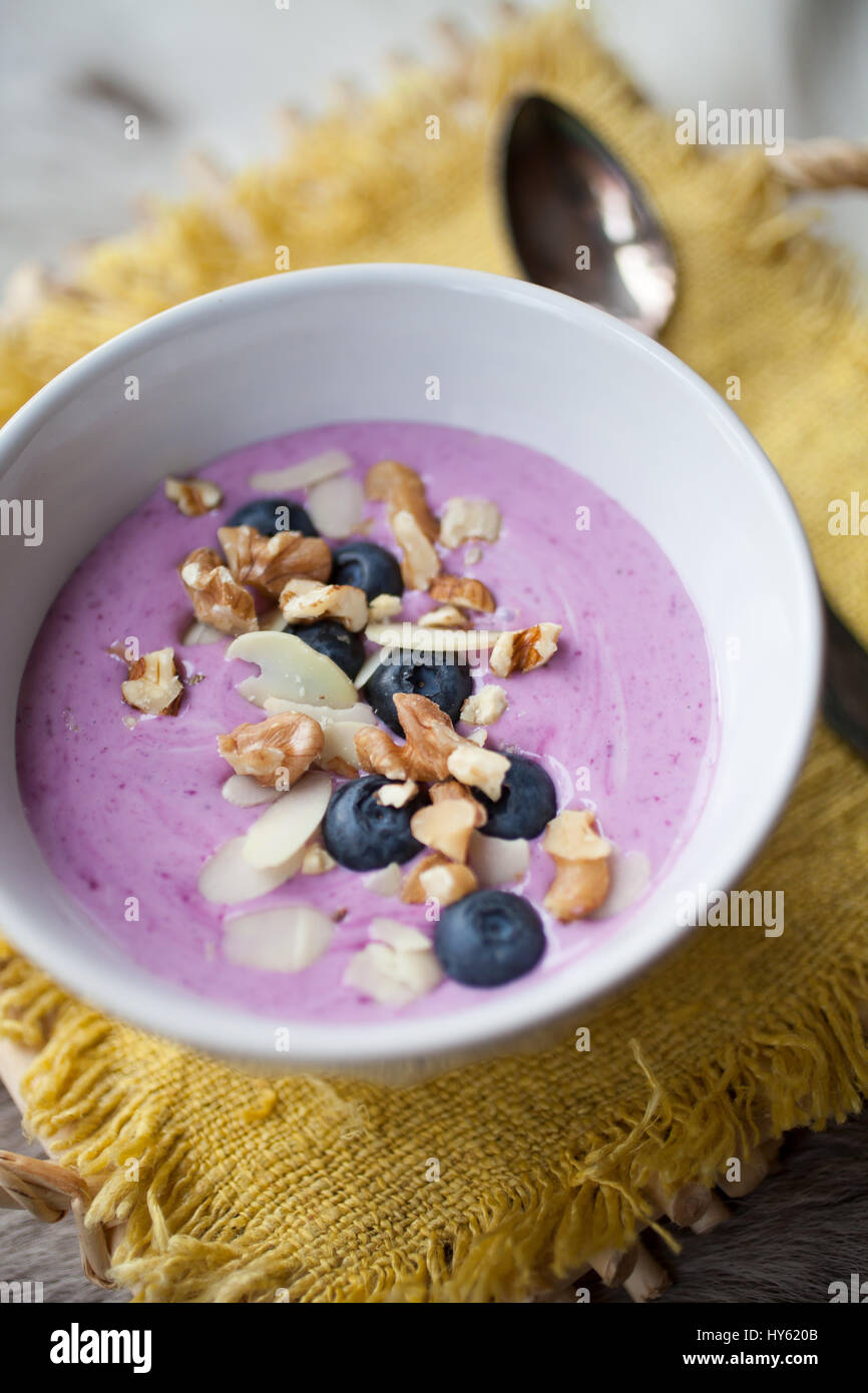 Smoothie bowl with blueberries and almond - Stock Image