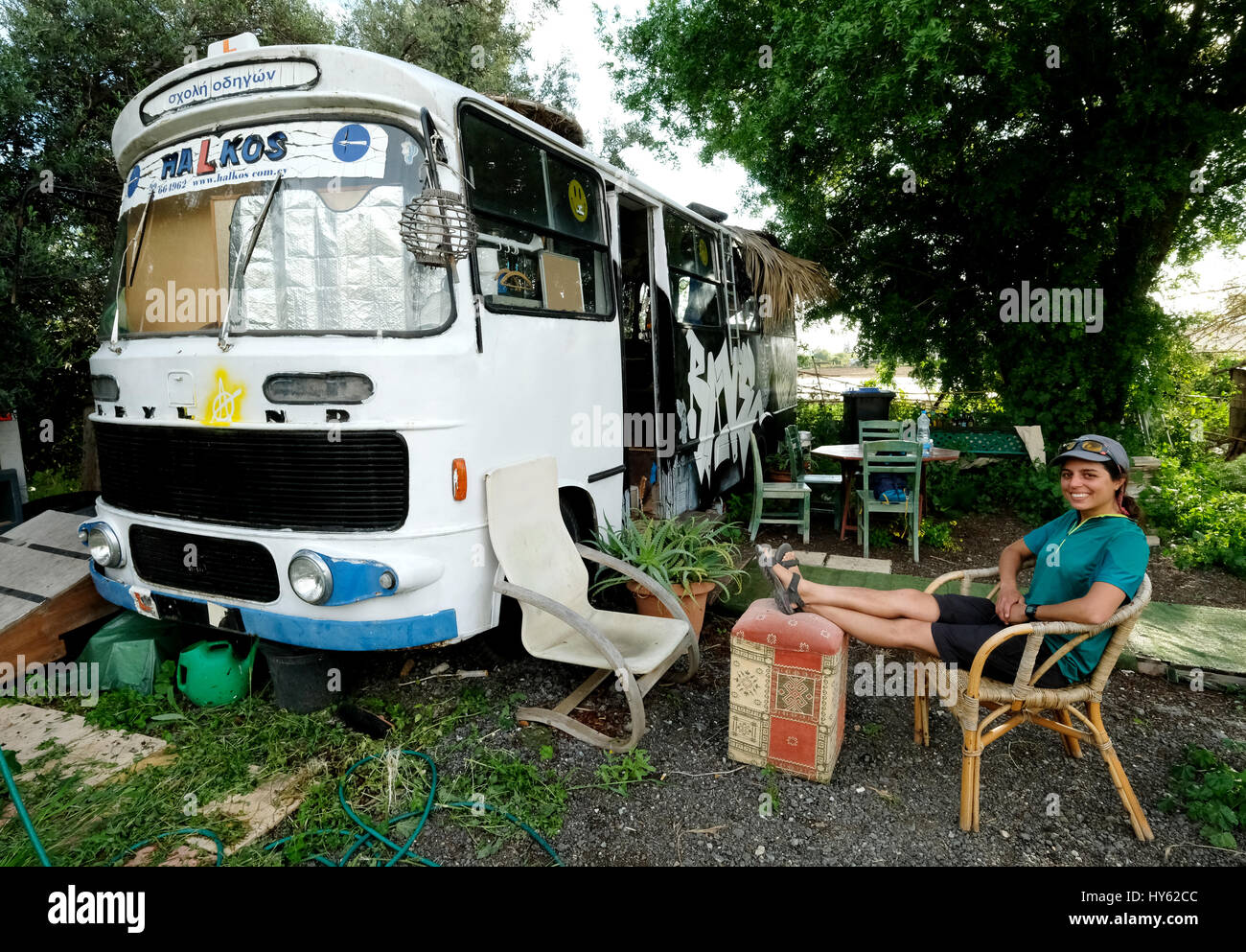 Backpacker Justine is staying in an old bus in Paphos,Cyprus. The bus was provided as free accommodation by a young - Stock Image