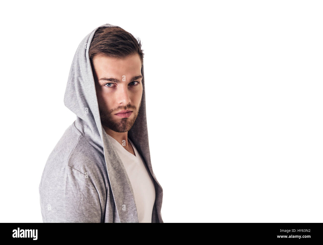 1dc66111 Handsome young man in grey hoodie sweater isolated on white Stock ...