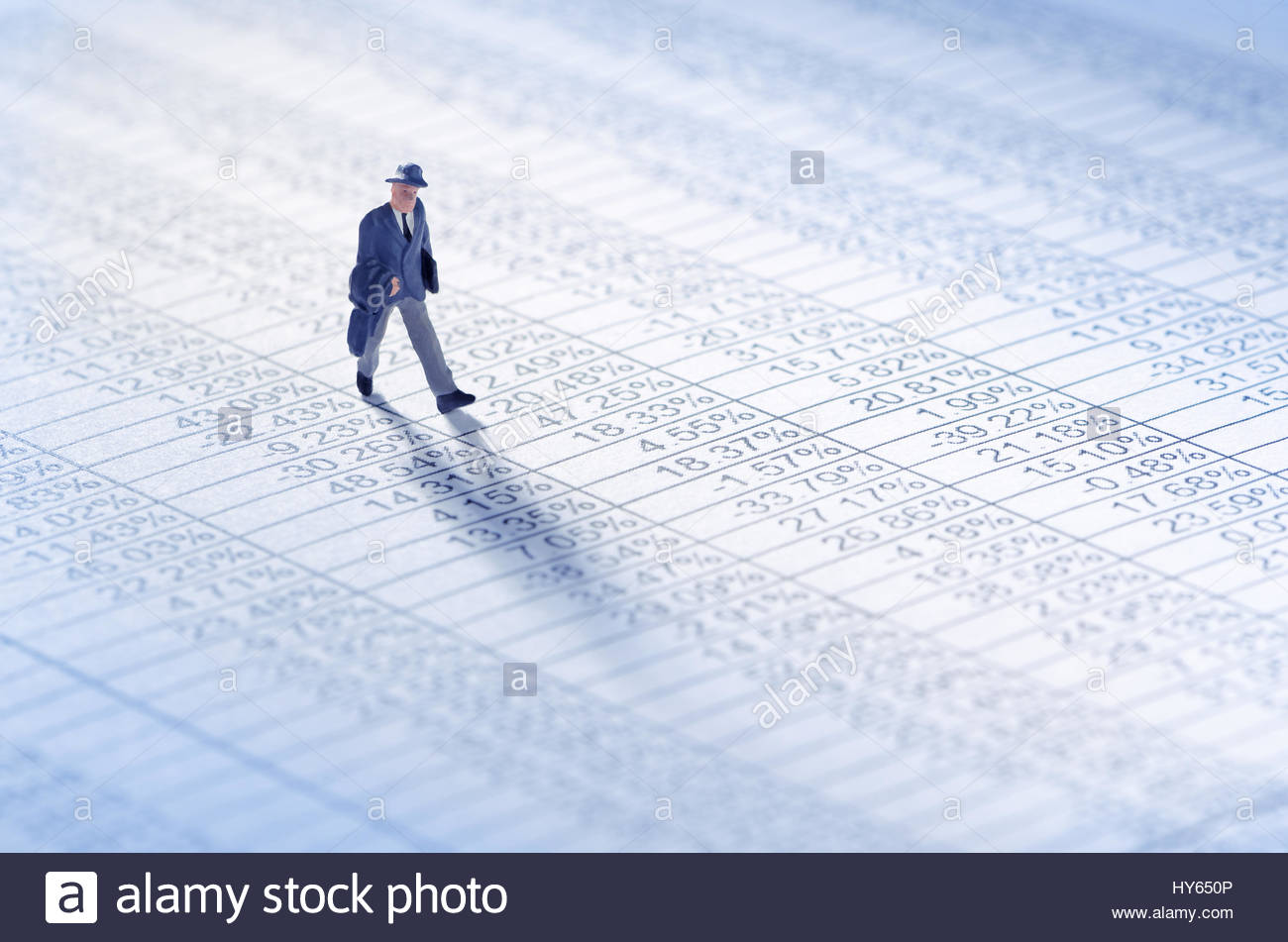 Businessman playing the stock market - Stock Image