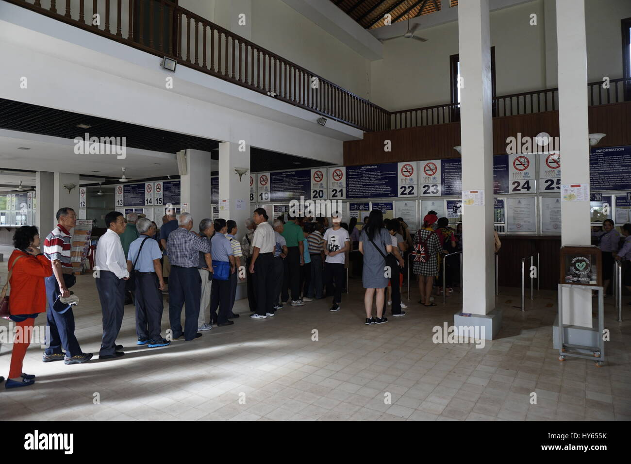 tourists queueing to buy tickets at Angkor Wat ticketing office Stock Photo