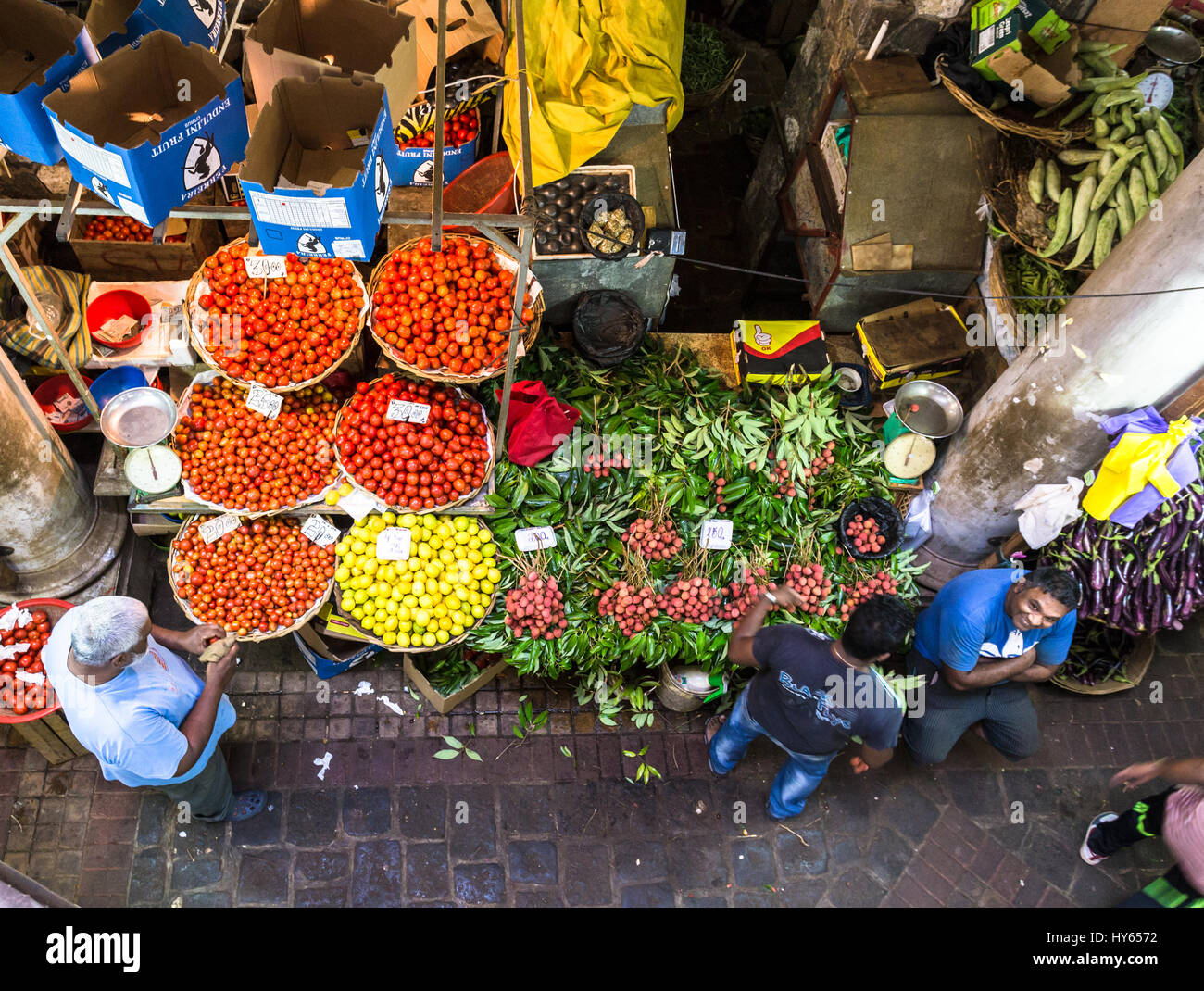 PORT LOUIS, MAURITIUS - NOVEMBER 18, 2016: People shops for fresh fruits and vegetables in the traditional fresh Stock Photo