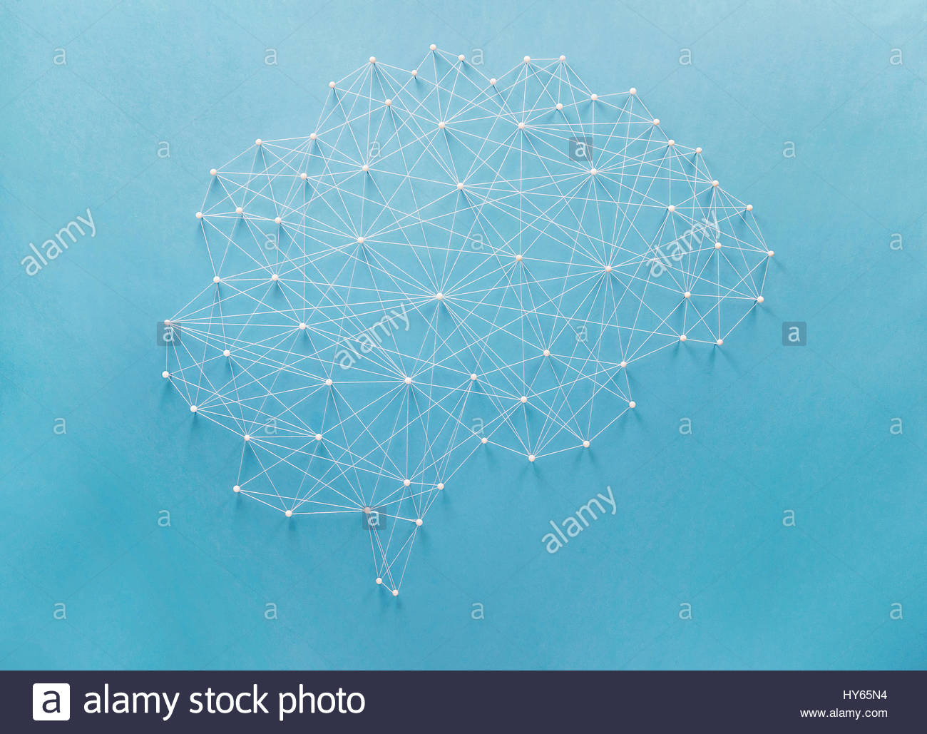 Neural network created by pins and threads - Stock Image