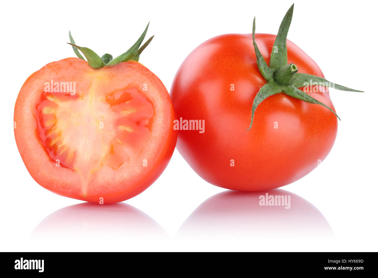 Tomatoes tomato sliced vegetable isolated on a white background - Stock Image