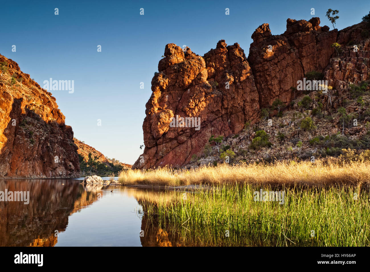 Reflections of rock formations at Glen Helen Gorge water hole in Northern Territory Central Australia - Stock Image