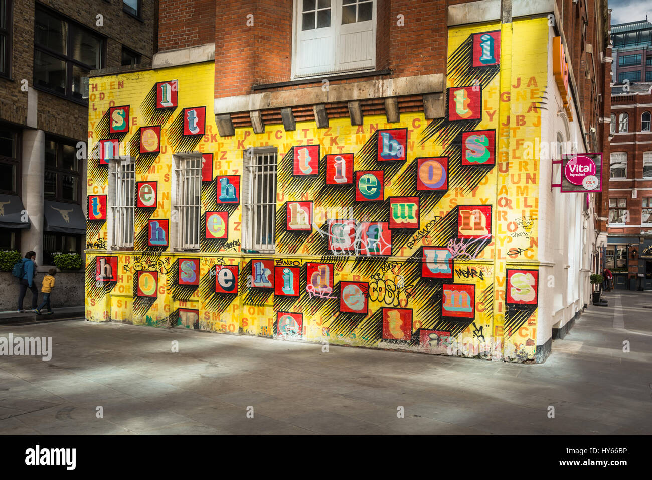'Alphabet House', street art by Ben Eine - colourful alphabet letters on a yellow wall in Spitalfields, - Stock Image