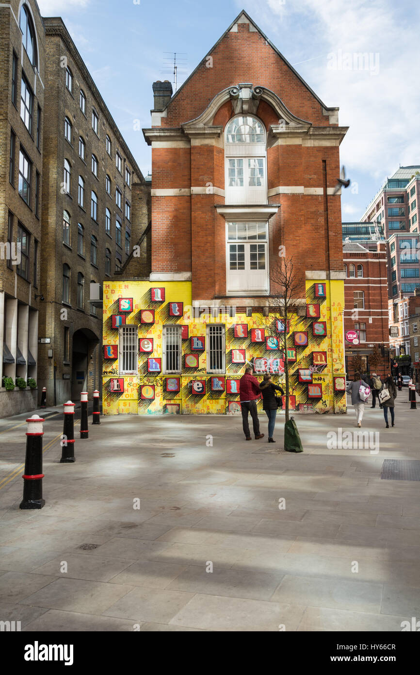 'Alphabet House', Street art by artist Ben Eine - colourful alphabet letters on a yellow wall in Spitalfields, - Stock Image