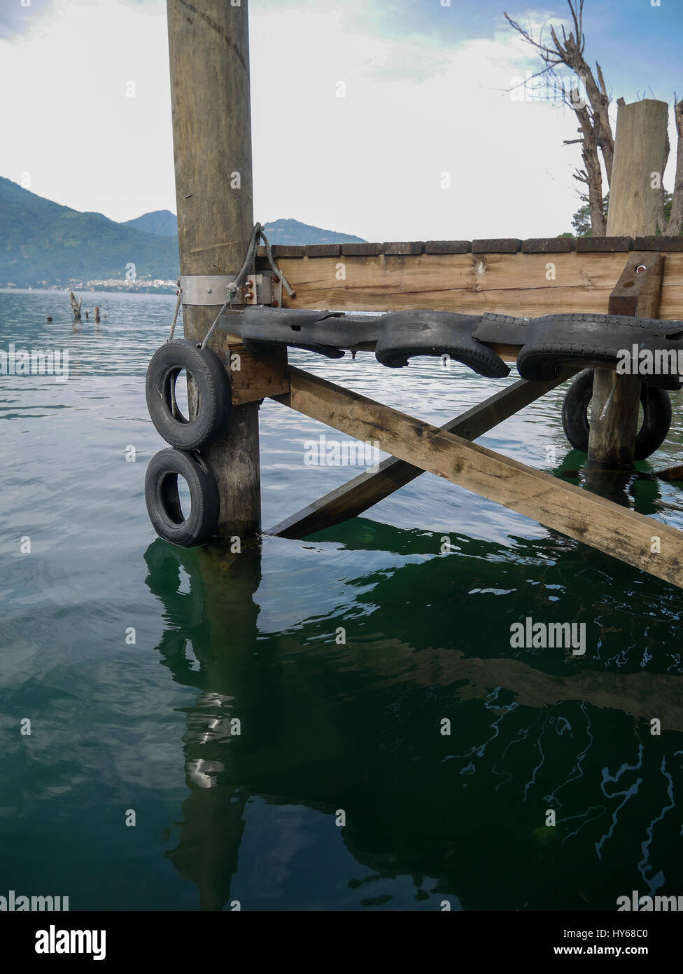 Wooden bridge port for boats and passengers to hop on and hop off the boats on Atitlan lake Guatemala - Stock Image
