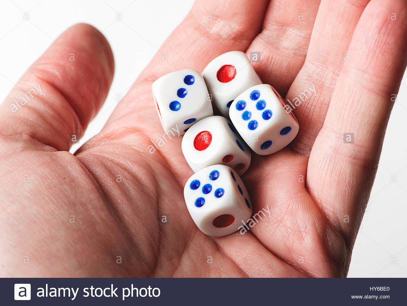 Dice on a hand. Isolated. Stock Photo