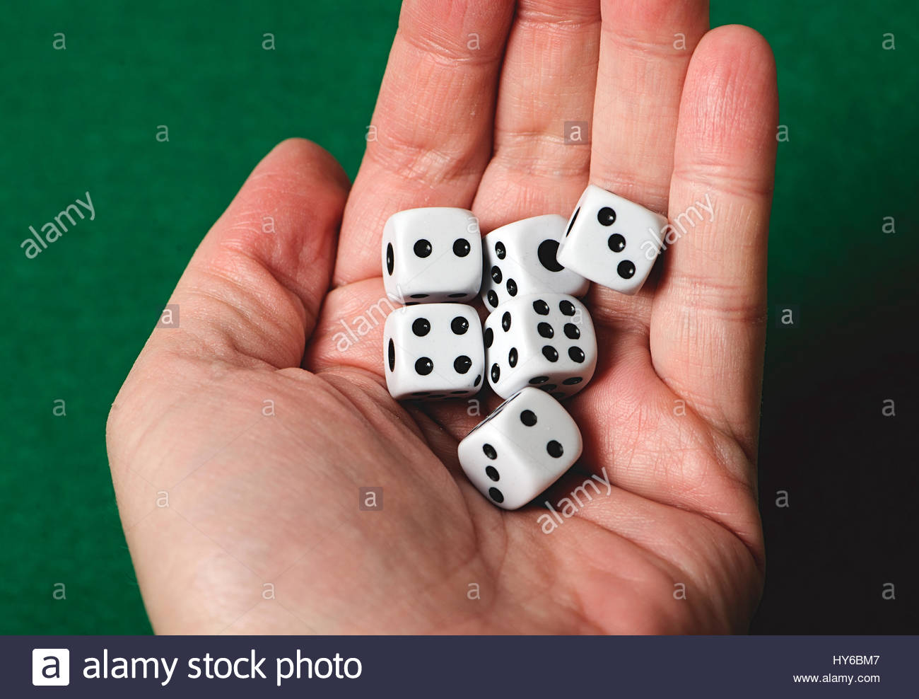 White dice on a hand. Isolated. Stock Photo