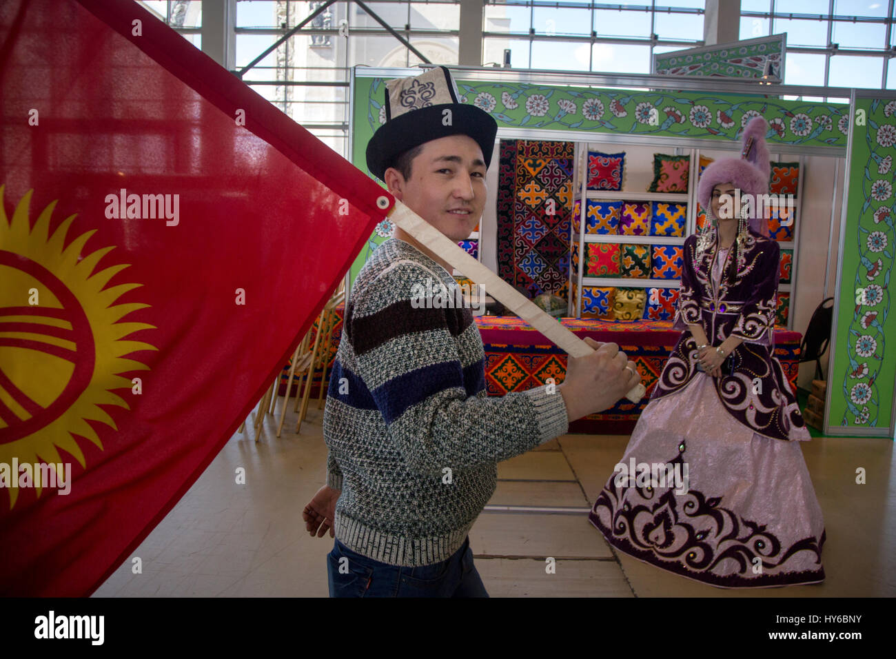 A man with the national flag of Kyrgyzstan during the Navruz holiday at VDNKh in Moscow, Russia - Stock Image
