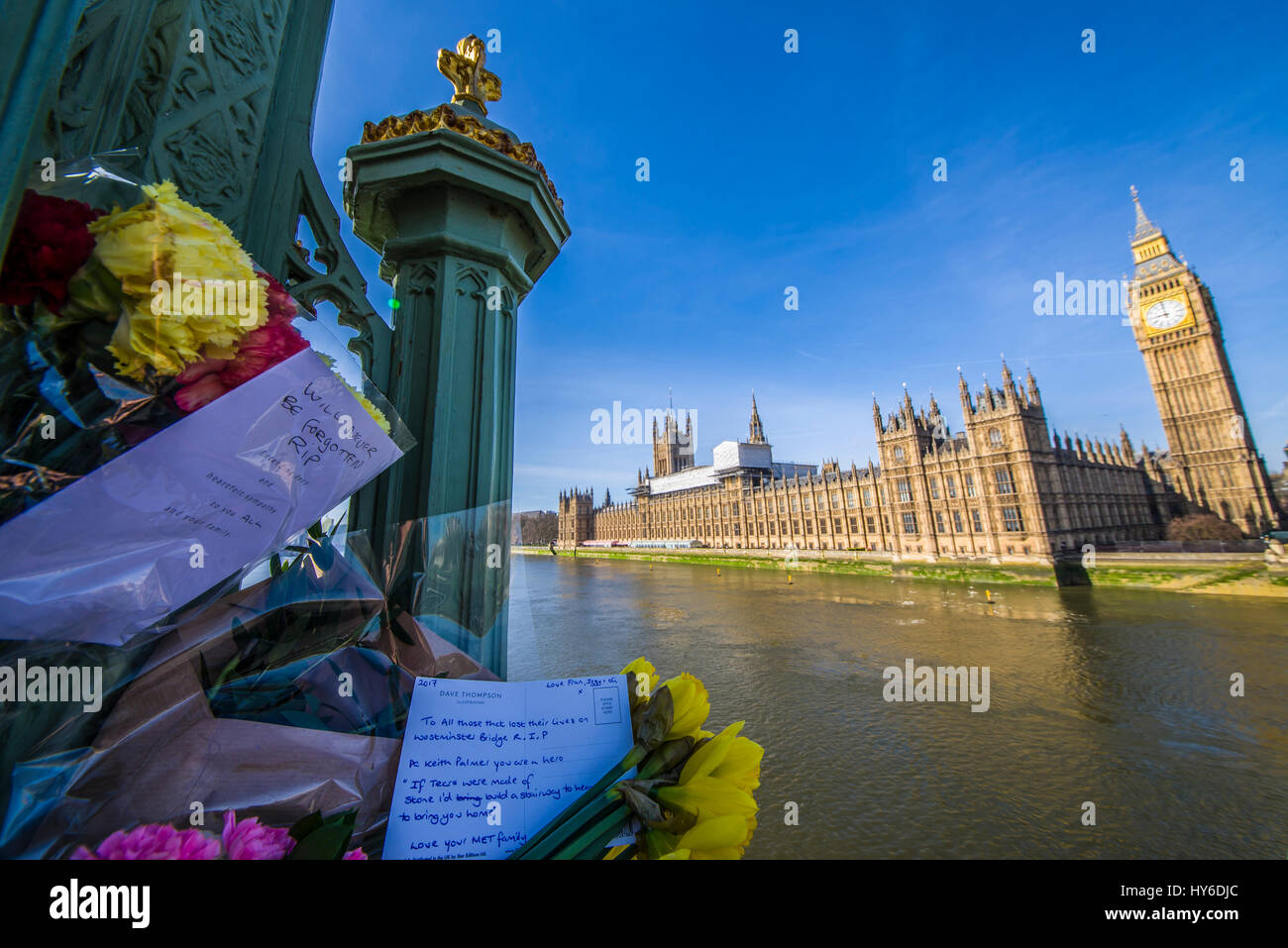 Floral tributes on Westminster Bridge, London, honouring the lives lost to terrorist action on 22 March 2017 here - Stock Image