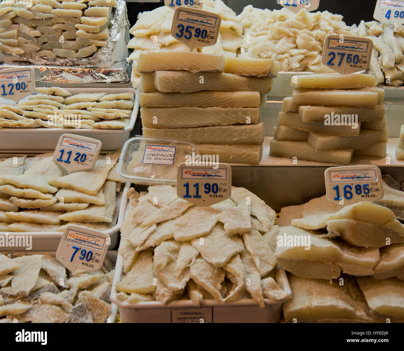 Dried fish on sale at a market stand at La Boqueria Market, Las Ramblas, Barcelona, Catalonia, Spain - Stock Image