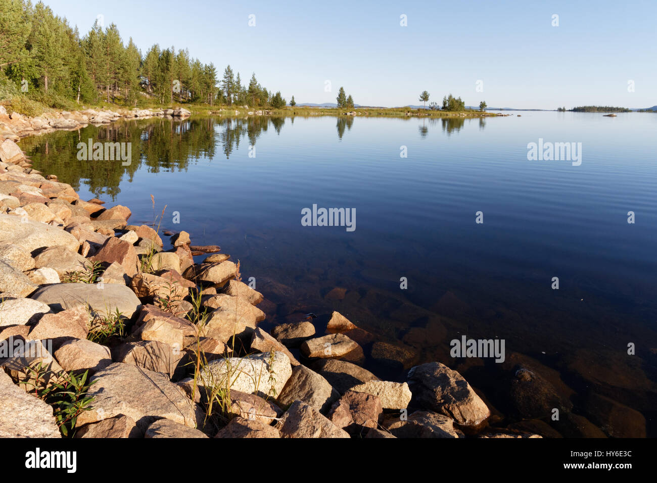 Calm, summer lake in Lappland in Northern Sweden - Stock Image