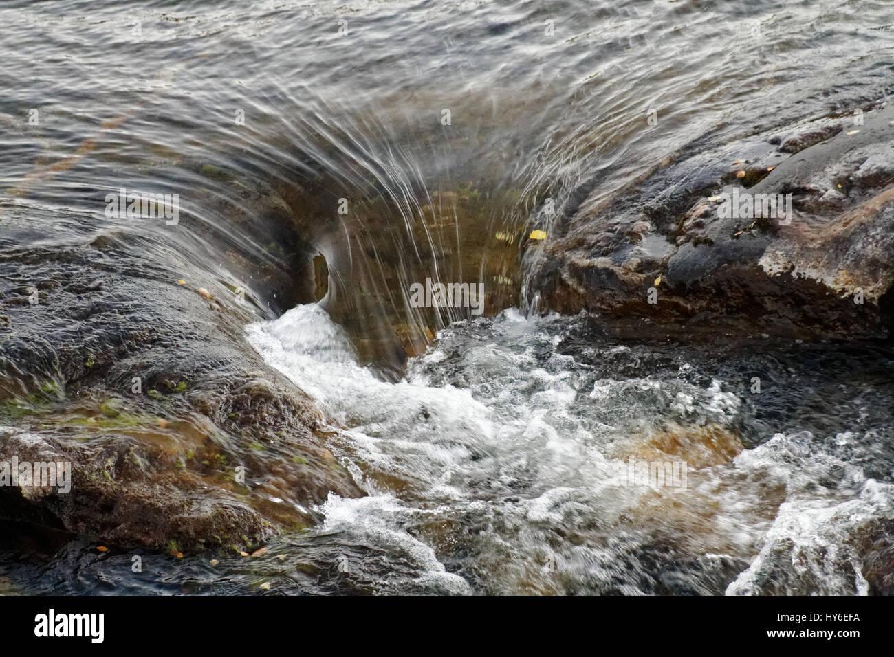 Water streaming down near Storforsen Rapids, Northern Sweden - Stock Image
