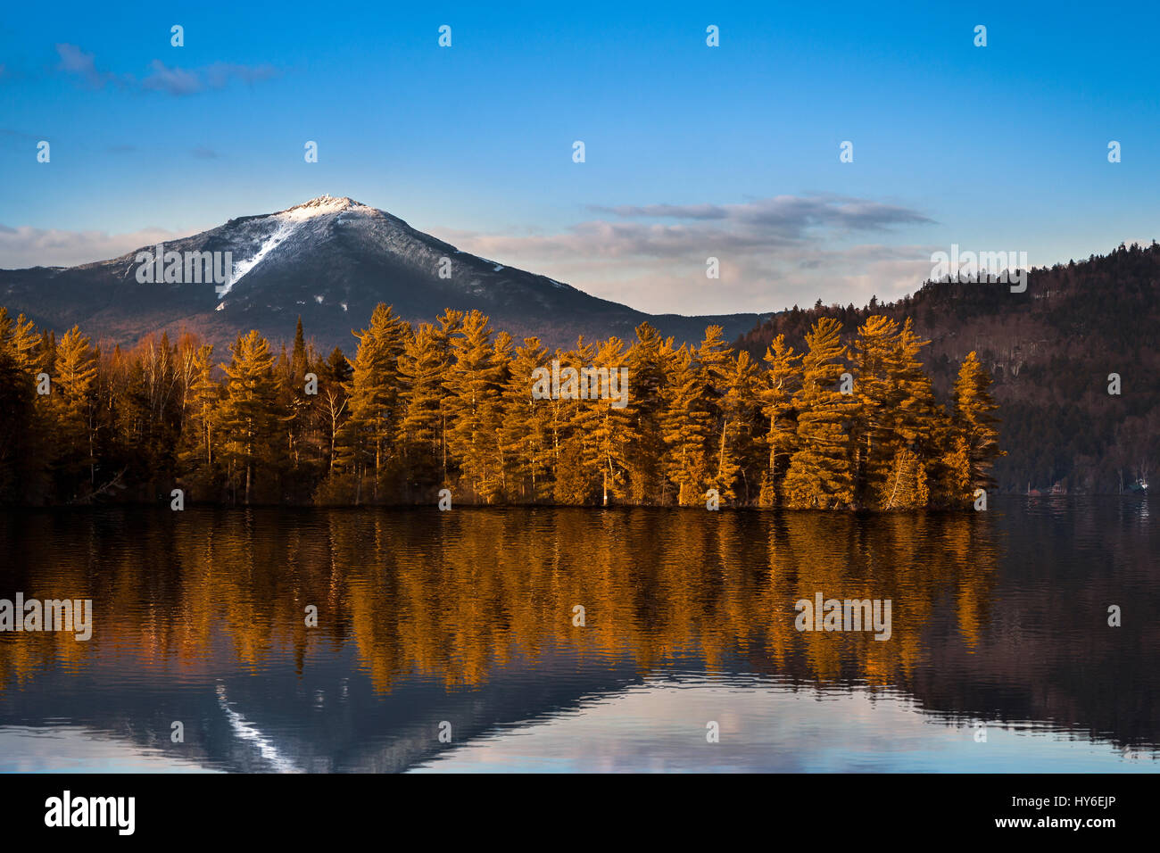 Snowy Whiteface mountain with reflections in Paradox Bay, Lake Placid, Upstate New York Stock Photo