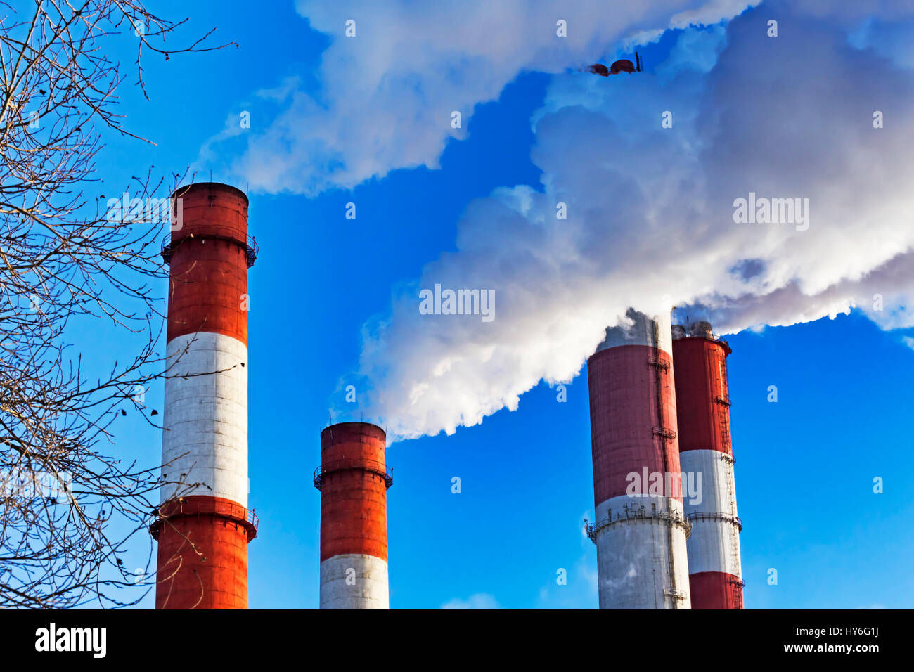 Chimneys with steam production of a thermal power station - Stock Image