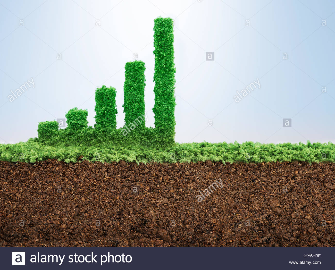 Business growth concept with grass growing in shape of graphic bar - Stock Image