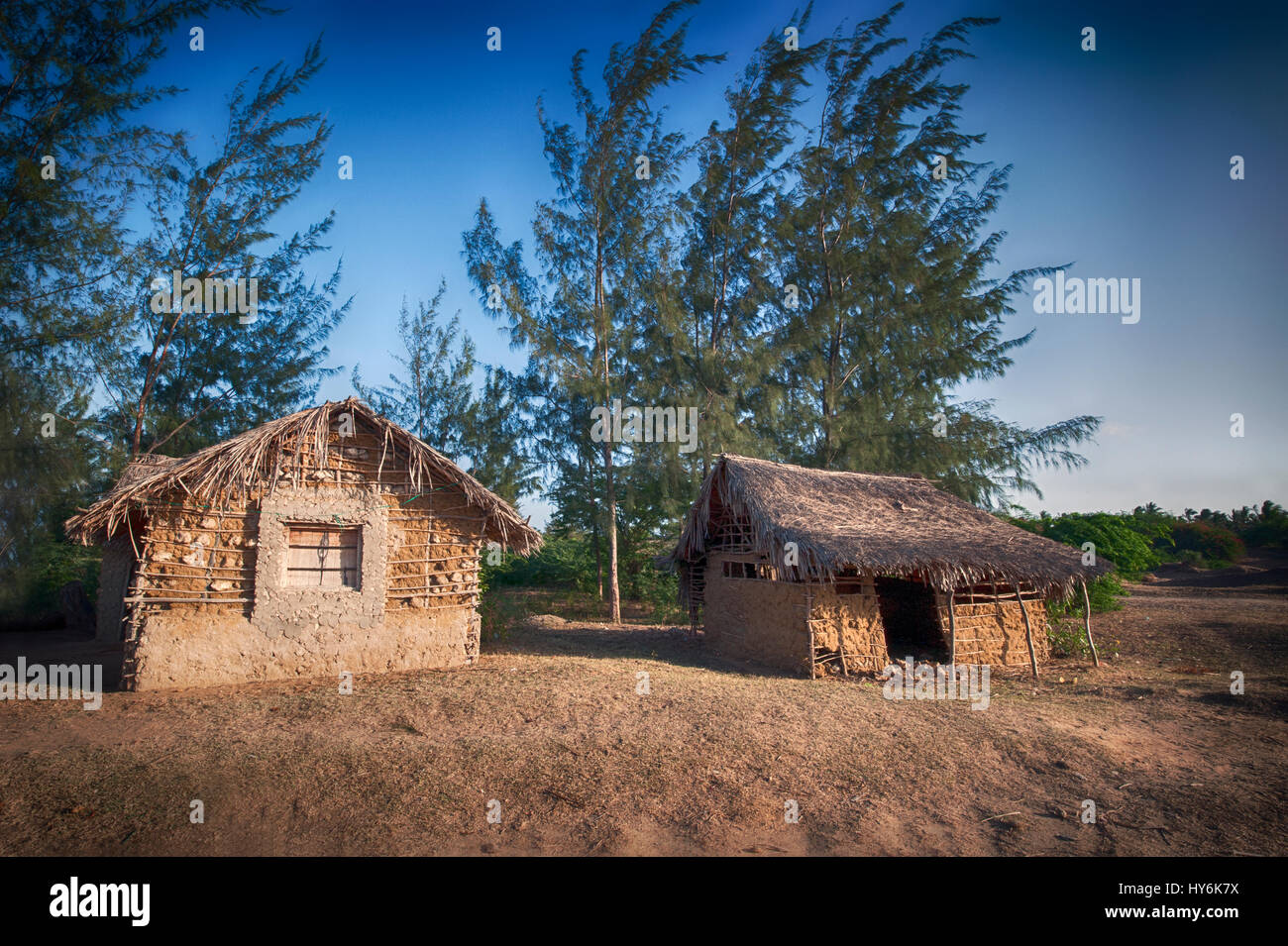 Isolated huts at sunset in Kenya - Stock Image