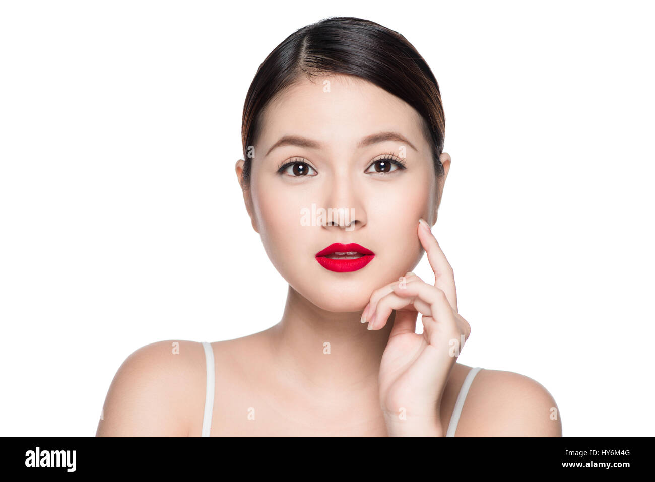 Beautiful asian woman with retro makeup with red lips isolated on white background.
