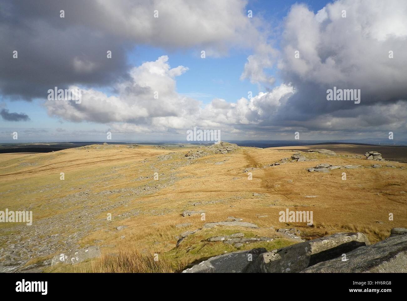 Clouds over Bodmin Moor looking from Rough Tor, one of the moor's highest peaks, to Little Rough Tor and Showery Stock Photo