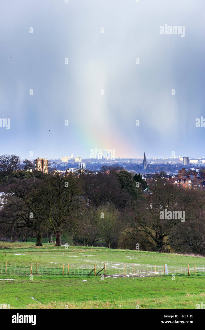 Unusual weather and rainbow over the City of London, UK - Stock Image