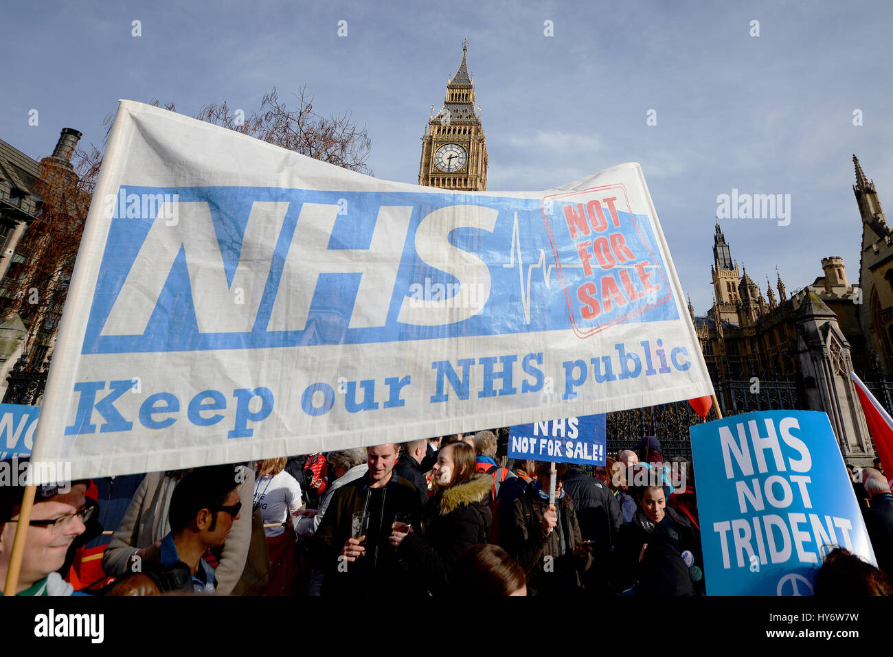 'Our NHS' protest march in London passing Parliament demonstrating against the cuts to and privatisation - Stock Image