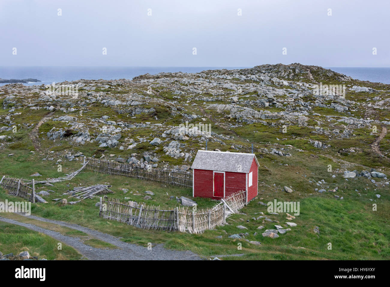 Rocky shore and red shed, Cape Bonavista, Newfoundland - Stock Image