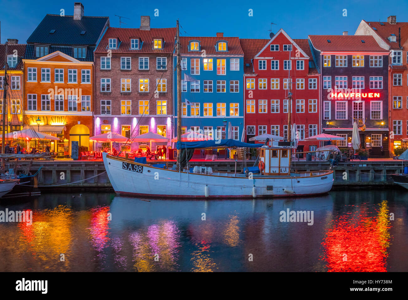 Nyhavn is a colourful 17th century waterfront, canal and popular entertainment district in Copenhagen, Denmark. Stock Photo