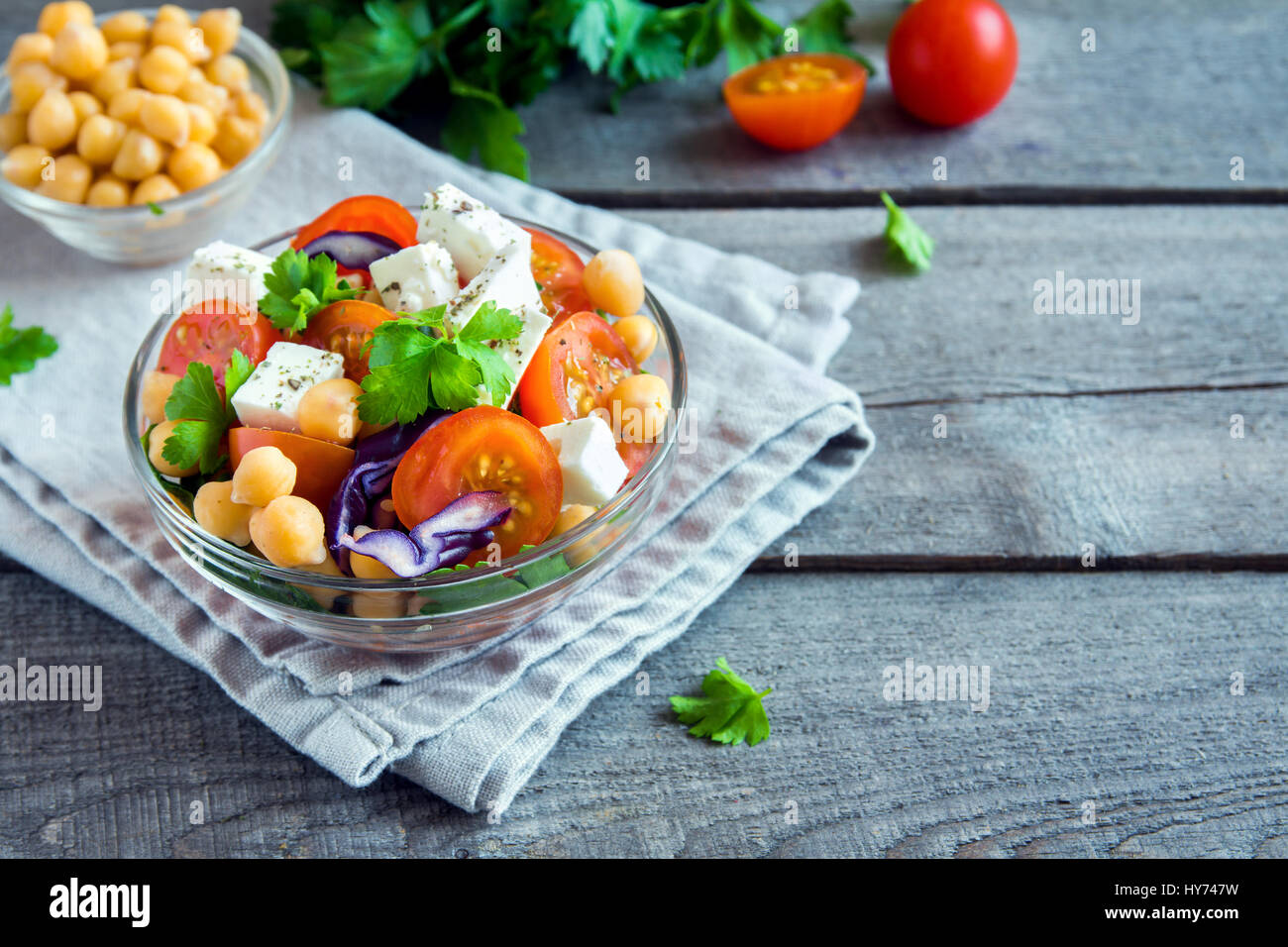 Chickpea and veggie salad with tomatoes, red cabbage, feta cheese (tofu) - healthy homemade vegan vegetarian diet - Stock Image