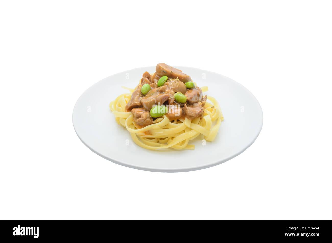 Pasta on white dish isolated on white - Stock Image
