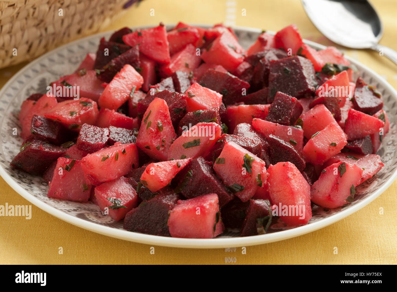 Dish with Moroccan salad with beets and potatoes close up - Stock Image