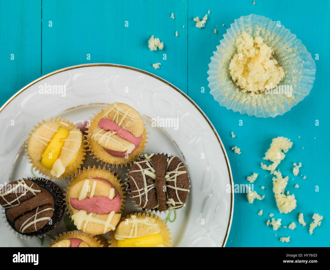 Selection of Easter Butterfly Cupcakes Against a Blue Background - Stock Image