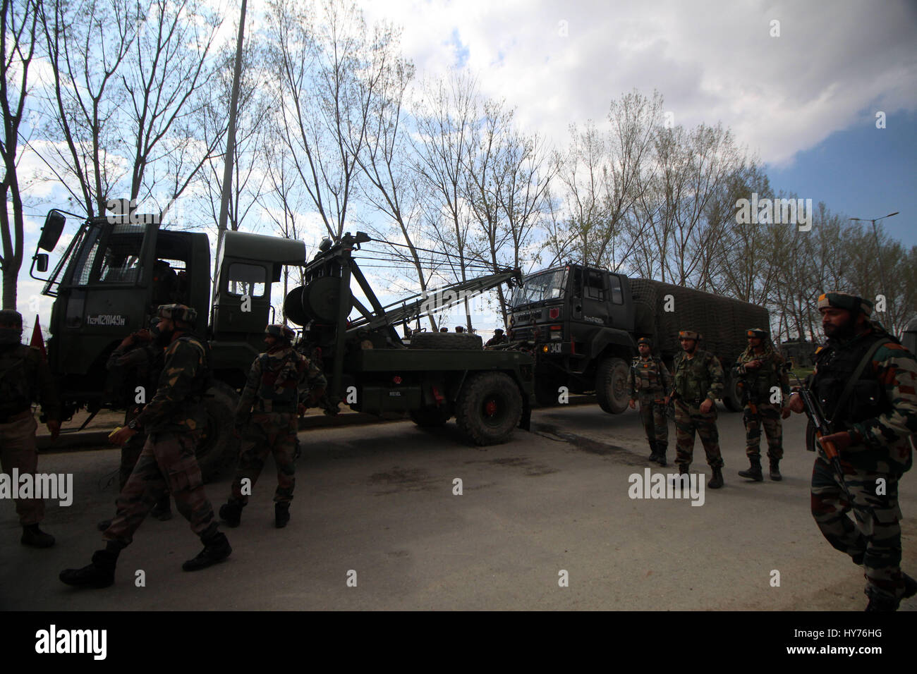 Srinagar, Kashmir. 01st Apr, 2017. Army troopers toeing the armored vehicle which was attacked by the suspected - Stock Image