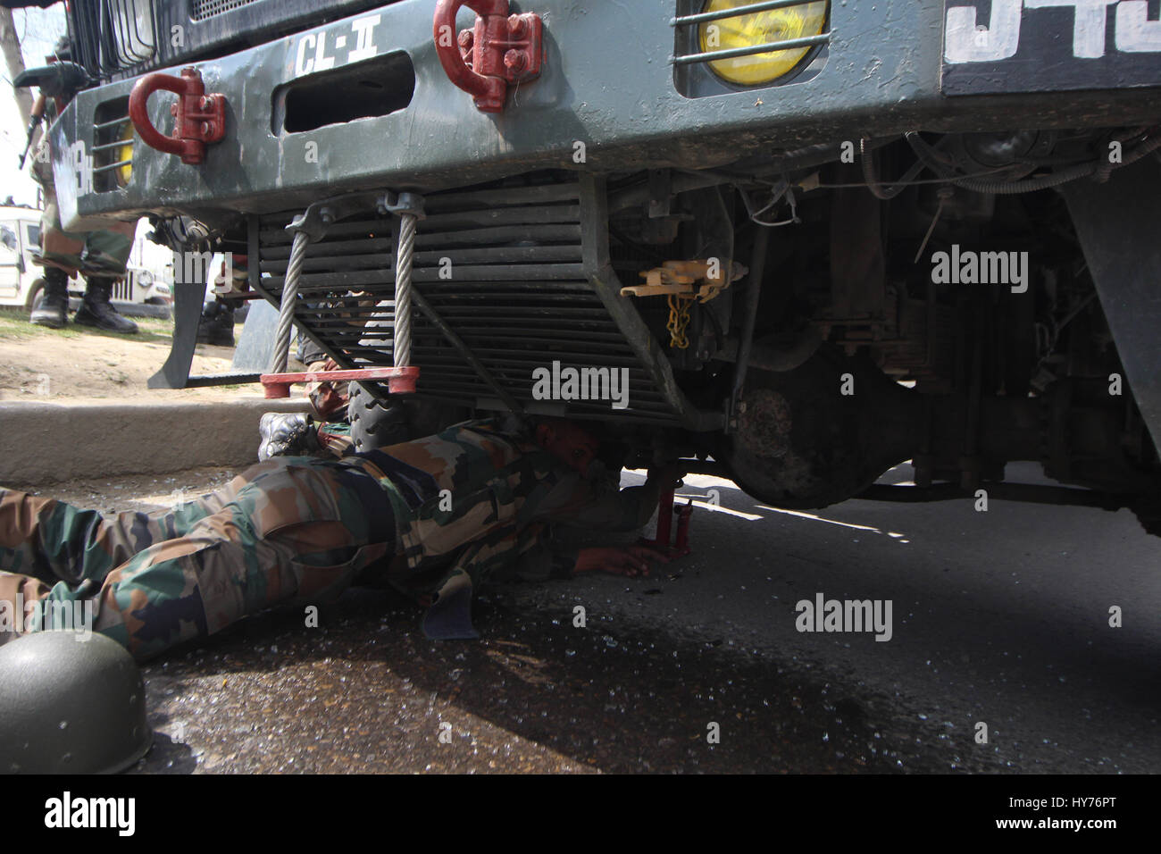 Srinagar, Kashmir. 01st Apr, 2017. Army trooper toeing the armored vehicle which was attacked by the suspected militants - Stock Image