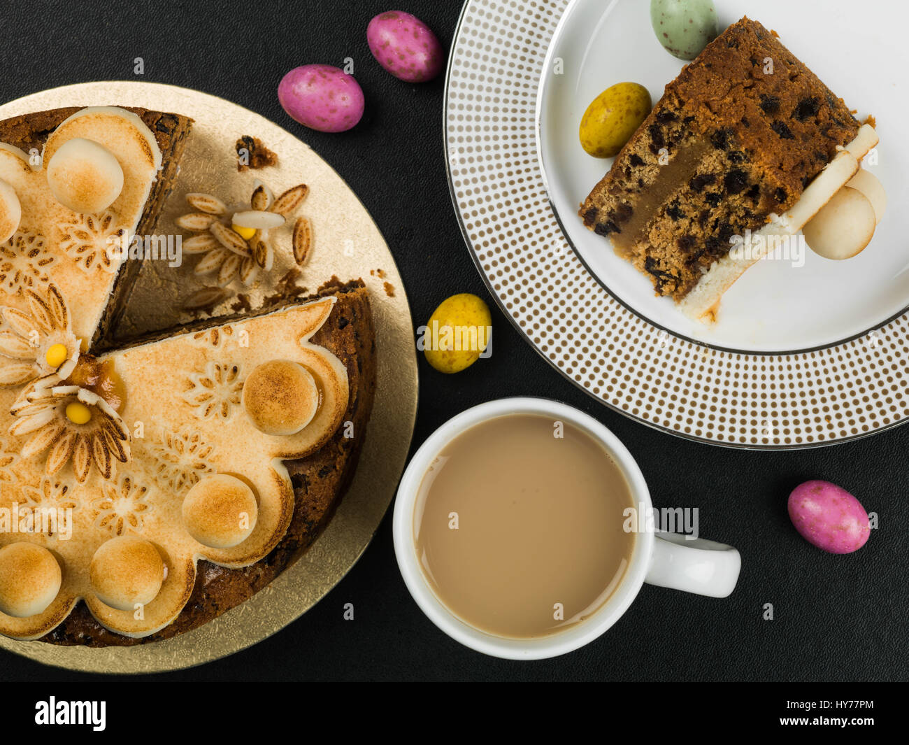 Easter Simnel Cake With Marzipan Icing and Decorations Against a Black Background - Stock Image