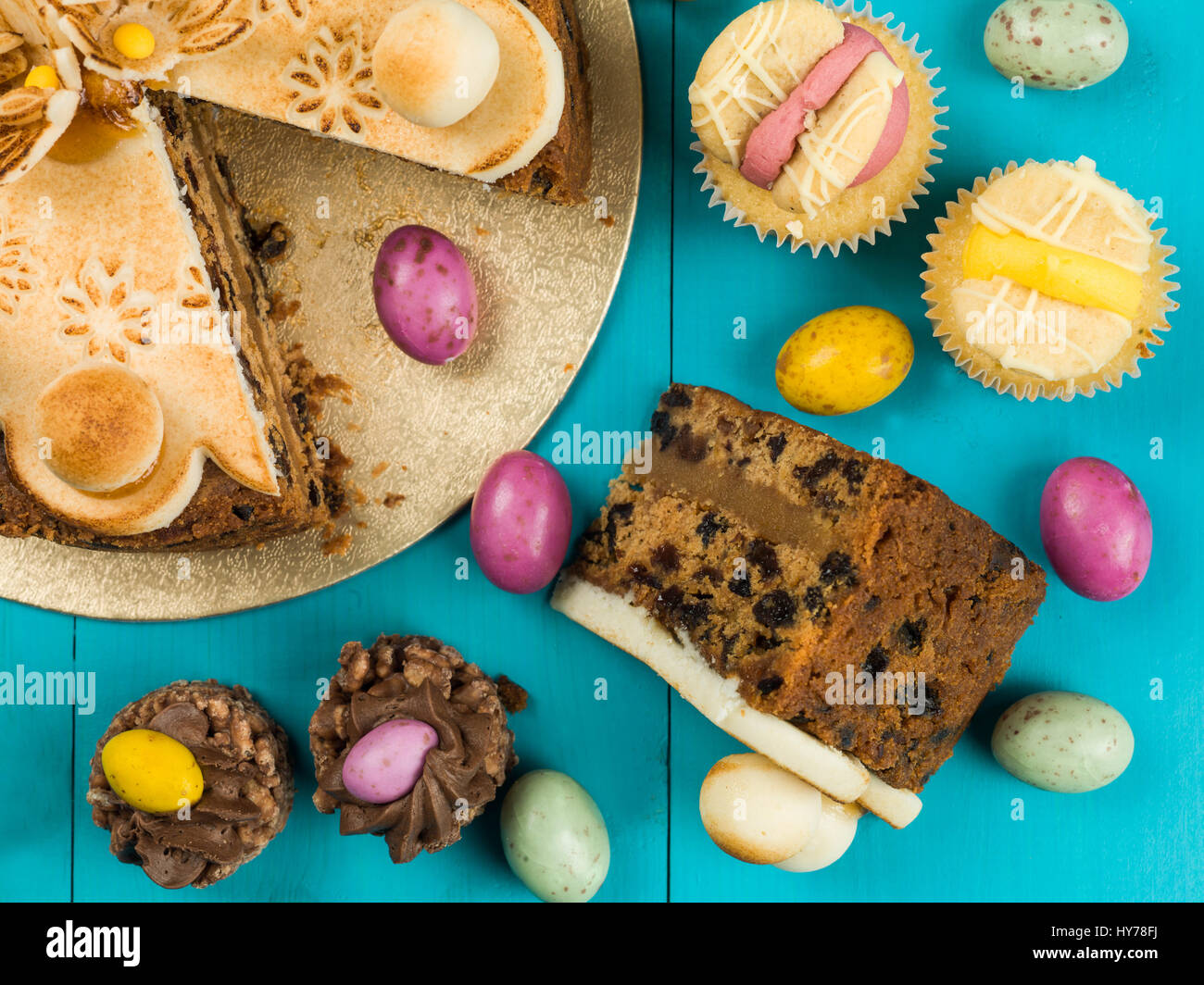 Traditional Easter Sunday Afternoon Tea and Cakes Against a Blue Background - Stock Image